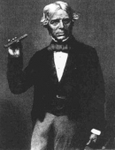 ФАРАДЕЙ Майкл (Faraday Michael), Michael Faraday holding a glass bar of the type he used in 1845 to show that magnetism can affect light in a dielectric material.